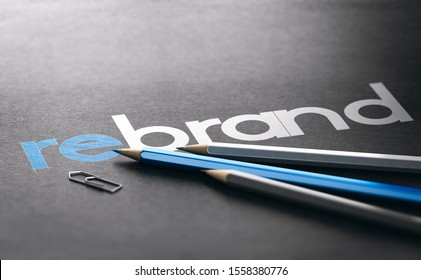 Word rebrand with the prefix re handwritten over black paper background, Marketing and brand management concept. 3D illustration