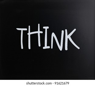 "The word ""Think"" handwritten with white chalk on a blackboard"