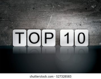"The word ""Top 10"" written in white tiles against a dark vintage grunge background."