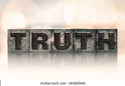 """The word """"TRUTH"""" written in vintage ink stained letterpress type."""