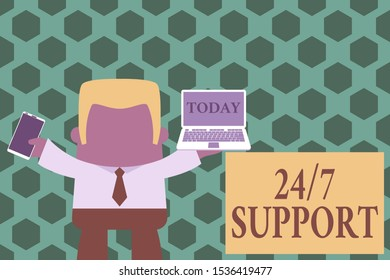 Word writing text 24 Or 7 Support. Business concept for Giving assistance to service whole day and night No downtime Standing professional man tie holding left open laptop right mobile phone.