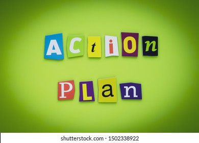 A word writing text - action plan. Cut colorful letters on a yellow and green background. Headline on banner. Inscription. Planning concept.