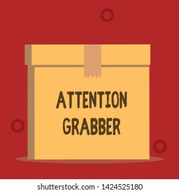 Word writing text Attention Grabber. Business concept for Deanalysisding notice mainly by being prominent or outlandish Close up front view open brown cardboard sealed box lid. Blank background.