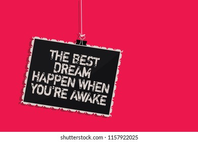 Word writing text The Best Dream Happen When You re are Awake. Business concept for Dreams come true Have to believe Hanging blackboard message communication information sign pink background.
