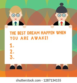 Word writing text The Best Dream Happen When You Are Awake. Business concept for Stop dreaming start acting Male and Female in Uniform Standing Holding Blank Placard Banner Text Space.