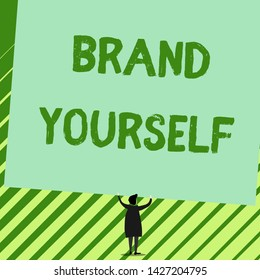 Word writing text Brand Yourself. Business concept for Develop a unique professional identity Personal product Man stands in back view under huge empty blank big tilted rectangle board.