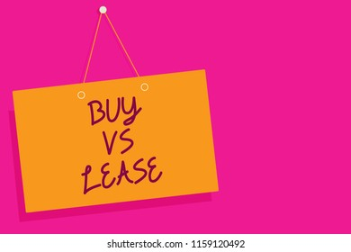 Word writing text Buy Vs Lease. Business concept for Own something versus borrow it Advantages Disadvantages Orange board wall message communication open close sign pink background.