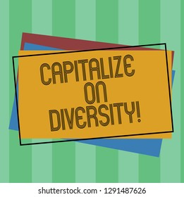Word writing text Capitalize On Diversity. Business concept for Bringing together workers with different ethnicity Pile of Blank Rectangular Outlined Different Color Construction Paper.