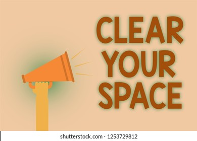 Word writing text Clear Your Space. Business concept for Clean office studio area Make it empty Refresh Reorganize Hand brown loud speaker sound public message hot issue announcement.