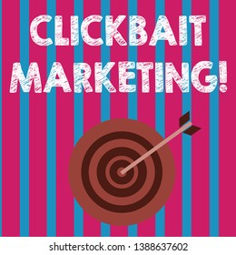 Word writing text Clickbait Marketing. Business concept for Online content that aim to generate page views Color Dart Board in Concentric Style with Arrow Hitting the Center Bulls Eye.