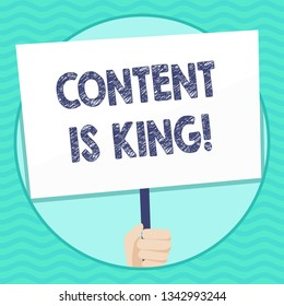 Word writing text Content Is King. Business concept for marketing focused growing visibility non paid search results Hand Holding Blank White Placard Supported by Handle for Social Awareness.