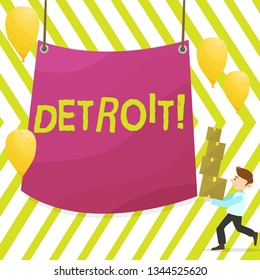 Word writing text Detroit. Business concept for City in the United States of America Capital of Michigan Motown Man Carrying Pile of Boxes with Blank Tarpaulin in the Center and Balloons.