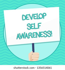 Word writing text Develop Self Awareness. Business concept for What you think you become motivate and grow Hand Holding Blank White Placard Supported by Handle for Social Awareness.