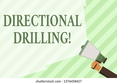 Word writing text Directional Drilling. Business concept for drilling for oil which the well not drilled vertically Hand Holding Megaphone with Blank Wide Beam for Extending the Volume Range.