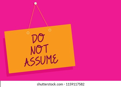 Word writing text Do Not Assume. Business concept for Ask first to avoid misunderstandings confusion problems Orange board wall message communication open close sign pink background.