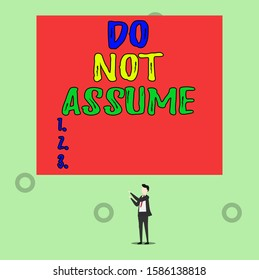 Word writing text Do Not Assume. Business concept for Ask first to avoid misunderstandings confusion problems Isolated view young man standing pointing upwards two hands big rectangle.