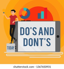 Word writing text Do S And Dont S. Business concept for Rules or customs concerning some activity or actions Man Leaning on Blank Smartphone Turned on Its Side with Graph and Idea Icon.