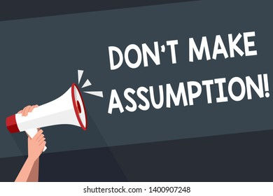 Word writing text Don T Make Assumption. Business concept for something that you assume to be case even without proof Human Hand Holding Tightly a Megaphone with Sound Icon and Blank Text Space.