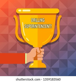 Word writing text Drilling Superintendent. Business concept for responsibilities of drilling program oil well Hand Holding Blank Golden Championship Winners Cup Trophy with Reflection.