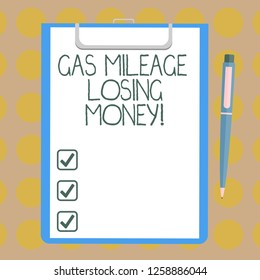 Word writing text Gas Mileage Losing Money. Business concept for Long road high gas fuel costs financial losses Blank Sheet of Bond Paper on Clipboard with Click Ballpoint Pen Text Space.