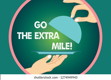Word writing text Go The Extra Mile. Business concept for Give an additional do more than is expected from you Hu analysis Hands Serving Tray Platter and Lifting the Lid inside Color Circle.