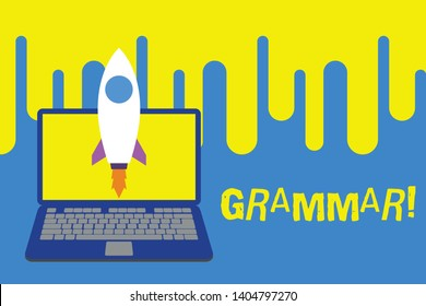 Word writing text Grammar. Business concept for whole system structure language syntax and morphology Launching rocket up laptop . Startup project. Developing goal objectives.