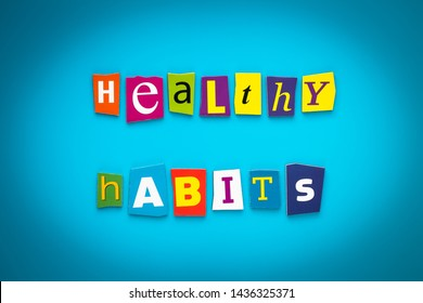 A word writing text - healthy habits - from cut letters on a blue background. Headline, card, banner with inscription. Psychologic, health concept. Caption, heading from colored letters. Message