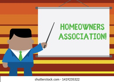 Word writing text Homeowners Association. Business concept for Organization with fee for upkeeps of Gated Community Businessman standing in front projector screen pointing project idea.