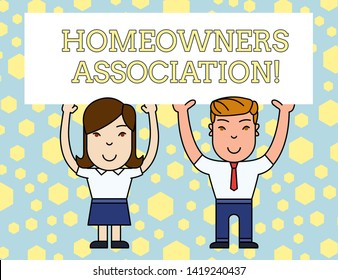 Word writing text Homeowners Association. Business concept for Organization with fee for upkeeps of Gated Community Two Smiling People Holding Big Blank Poster Board Overhead with Both Hands.