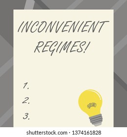 Word writing text Inconvenient Regimes. Business concept for overly strict adherence to a strategic planning regime Incandescent Light Bulb with Filament Inside Resting on Blank Color Paper.