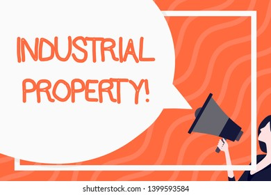 Word writing text Industrial Property. Business concept for the intangible ownership of a trademark or patent Huge Blank Speech Bubble Round Shape. Slim Woman Holding Colorful Megaphone.