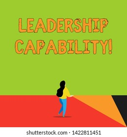 Word writing text Leadership Capability. Business concept for what a Leader can build Capacity to Lead Effectively Back view young long hair woman holding big blank square announcement.
