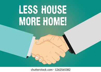 Word writing text Less House More Home. Business concept for Have a warm comfortable place to live with family love Hu analysis Shaking Hands on Agreement Greeting Gesture Sign of Respect photo.