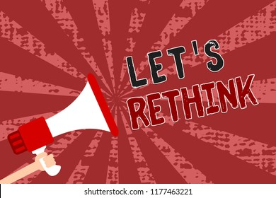 Word writing text Let s is Rethink. Business concept for an Afterthought To Remember Reconsider Reevaluate Man holding megaphone loudspeaker grunge red rays important messages.