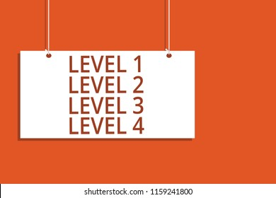Word writing text Level 1 Level 2 Level 3 Level 4. Business concept for Steps levels of a process work flow Hanging board message communication open close sign orange background.