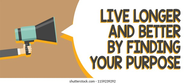 Word writing text Live Longer And Better By Finding Your Purpose. Business concept for Look for a goal set mission Man holding megaphone loudspeaker speech bubble message speaking loud.