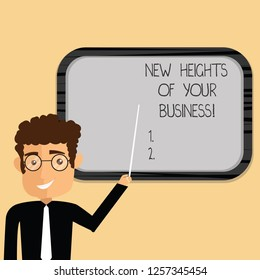 Word writing text New Heights Of Your Business. Business concept for Achieving goals fast growing up company Man Standing Holding Stick Pointing to Wall Mounted Blank Color Board.