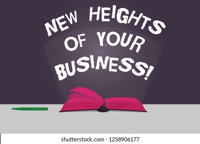 Word writing text New Heights Of Your Business. Business concept for Achieving goals fast growing up company Color Pages of Open Book photo on Table with Pen and Light Beam Glaring.
