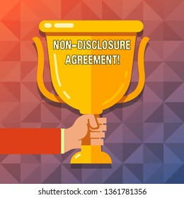 Word writing text Non Disclosure Agreement. Business concept for parties agree not disclose confidential information Hand Holding Blank Golden Championship Winners Cup Trophy with Reflection.