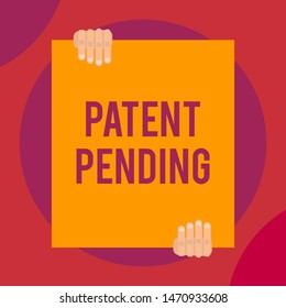 Word writing text Patent Pending. Business concept for Request already filed but not yet granted Pursuing protection Two hands holding big blank rectangle up down Geometrical background design.