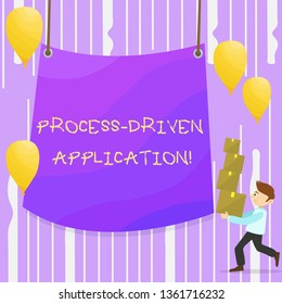 Word writing text Process Driven Application. Business concept for workflow engine where process can be exposed Man Carrying Pile of Boxes with Blank Tarpaulin in the Center and Balloons.