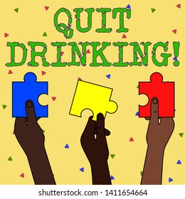 Word writing text Quit Drinking. Business concept for involves staying away from consuming alcoholic beverages Three Colored Empty Jigsaw Puzzle Pieces Held in Different People Hands.