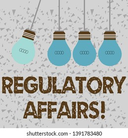 Word writing text Regulatory Affairs. Business concept for the desire of governments to protect public health Color Incandescent Pendant Bulb Hanging with One Different Shade Lightbulb.