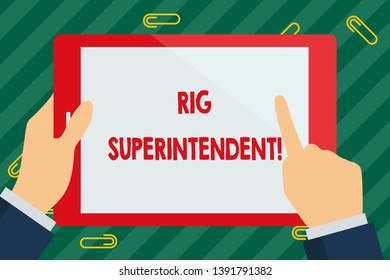 Word writing text Rig Superintendent. Business concept for Manage drilling operations to minimize rig down time Businessman Hand Holding, Pointing and Touching Colorful Tablet Blank Screen.