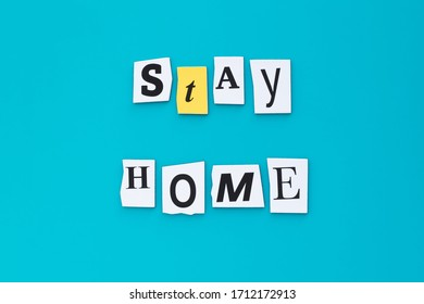 A word writing text - stay home. Cut letters on a turquoise background. Headline, banner with inscription. Coronavirus prevention, quarantine concept.