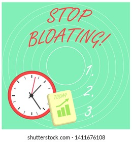 Word writing text Stop Bloating. Business concept for to end the condition where your belly feels full and tight Layout Wall Clock Notepad with Escalating Bar Graph and Arrow Pointing Up.