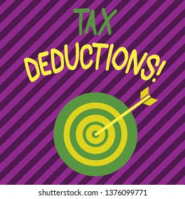 Word writing text Tax Deductions. Business concept for reduction income that is able to be taxed of expenses Color Dart Board in Concentric Style with Arrow Hitting the Center Bulls Eye.