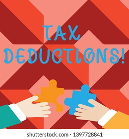 Word writing text Tax Deductions. Business concept for amount or cost that can be subtracted from someone s is income Two Hands Holding Colorful Jigsaw Puzzle Pieces about to Interlock the Tiles.