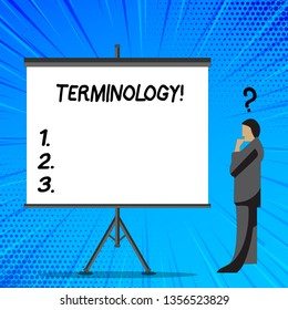 Word writing text Terminology. Business concept for Collection of terms used by different profession study industry Businessman with Question Mark Above his Head Standing Beside Blank Screen.
