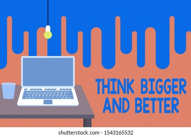 Word writing text Think Bigger And Better. Business concept for no Limits be Open minded Positivity Big Picture Front view open laptop lying on wooden desktop light bulb falling glass.